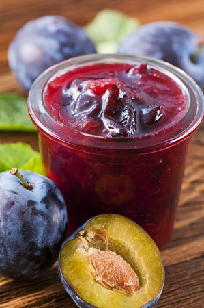 Plum marmalade with fresh plums photo