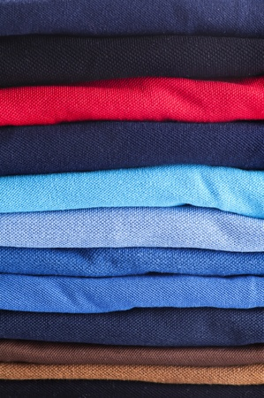 synthetic fiber: polo shirts stacked close up