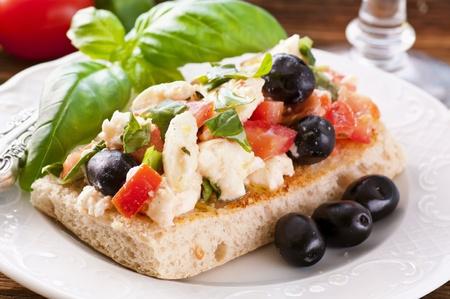 sandwich spread: Bruschetta on focaccia with feta and olives