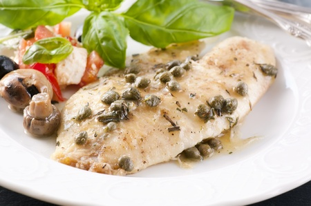 Fish piccata with capers photo