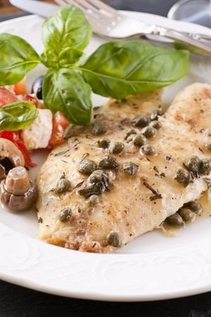 tilapia: Fish piccata with salad  Stock Photo