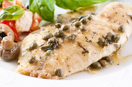 Tilapia fillet in white wine sauce with capers