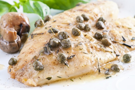 Fish fillet in white wine sauce photo
