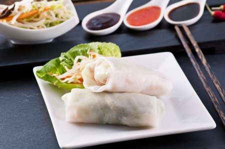 Spring rolled with different sauces photo