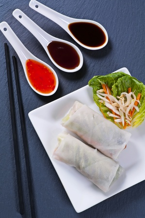 nem: Spring rolls with different sauces Stock Photo