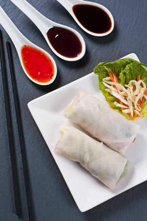 Spring rolls with salad and sauces photo