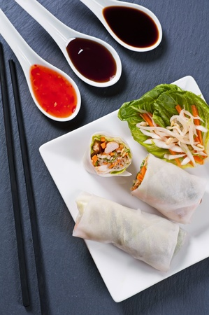 cha: spring rolls with salad and sauces Stock Photo
