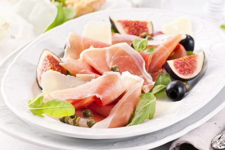 Prosciutto with parmesan and figs photo