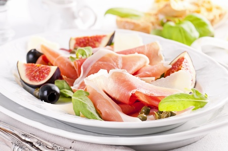 Italian antipasto with prosciutto and rucola photo