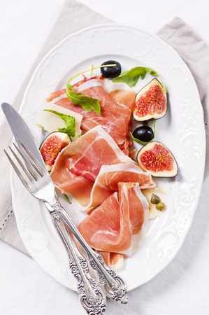 italian antipasto with prosciutto and figs photo