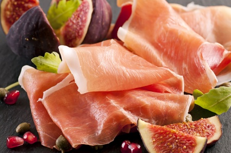 cold cuts: Prosciutto with figs and capers Stock Photo