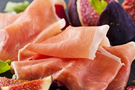 Italian prosciutto as closeup photo
