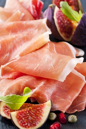 pomegranat: Prosciutto with figs and rucola Stock Photo