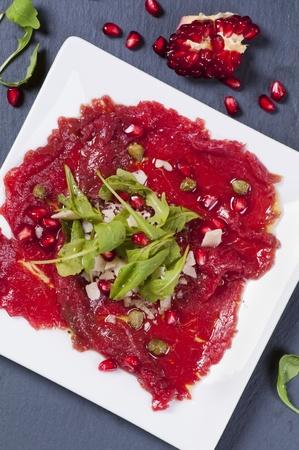 carpaccio: carpaccio with parmesan and pomegranate