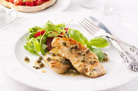 roquette: chicken piccata with arugula salad