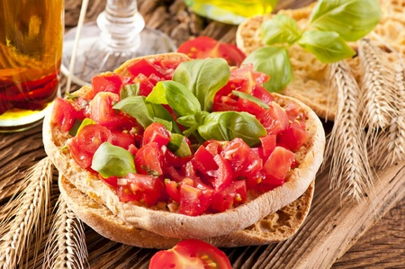 Le Freselle with fresh bruschetta and olive oil photo