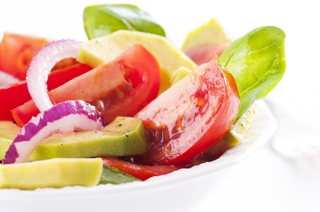 Fresh mix salad with tomato and avocado photo