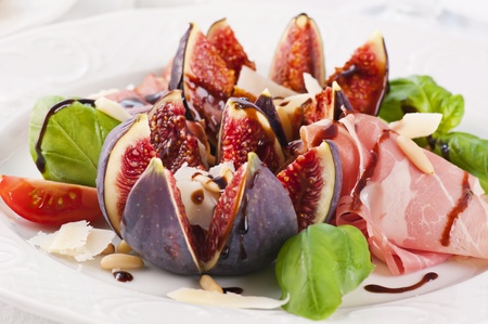 Tapas with prosciutto and figs photo