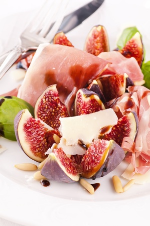 Fig with prosciutto and parmesan as starter photo