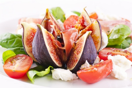 Fig with salad and prosciutto photo