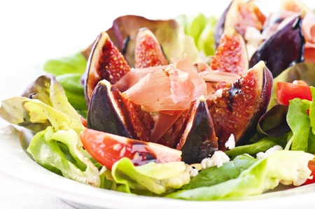 Salad with fig and prosciutto photo