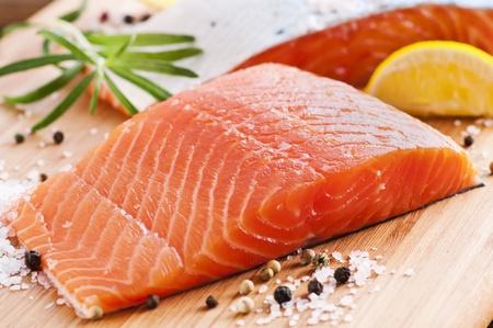 Fresh salmon on a wooden board photo