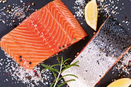 rosmarin: frehs salmon steaks on a black plate Stock Photo