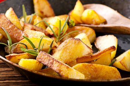 fried potato with herbs Stock Photo