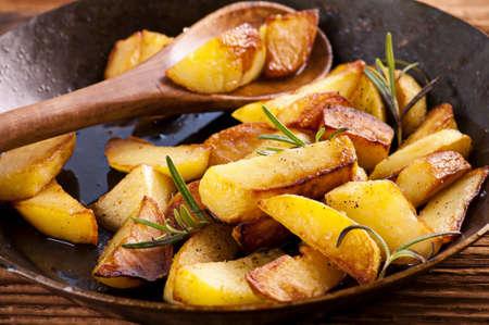 rosmarin: fried potato wth rosmarin Stock Photo
