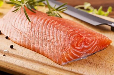 Salmon filet with fresh herbs photo