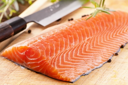 Salmon filet on a wooden board Stock Photo