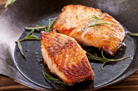 salmon steaks fried in the iron pan  photo