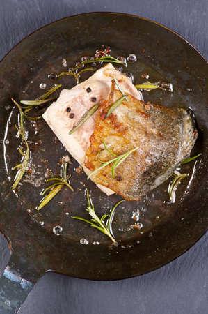 rosmarin: fish steak fried in the pan