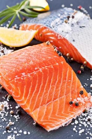 Fresh salmon on black plate photo