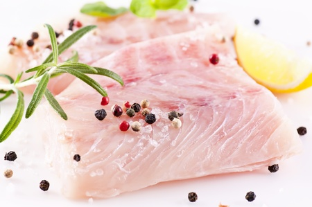 ocean perch fillet with fresh herbs and spices photo