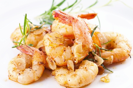fried black tiger prawns with herbs and spices photo