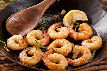 fried king prawns in iron pan photo