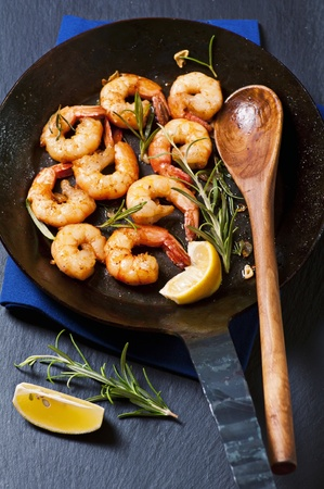 gambas: Butter prawns with fresh rosmarin Stock Photo
