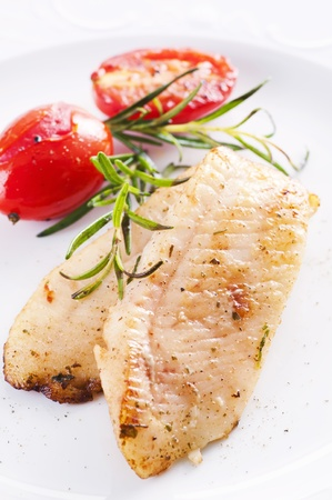 fish fillet fried with fresh herbs photo