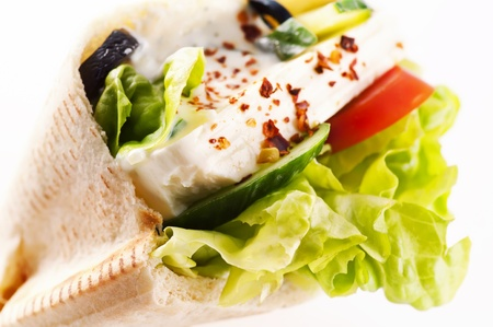 Pita bread stuffed with Feta and vegetables photo