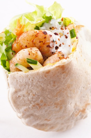 PIta stuffed with king prawn and yoghurt dip photo
