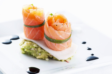 balsamic: Salmon rolls with avocado cream Stock Photo