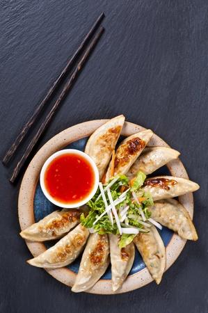 gyoza: Fried Gyoza with salad and dip Stock Photo