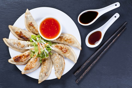 Fried Jiaozi with dipping sauces photo