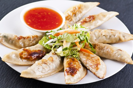 potstickers: Fried Guoties with chili sauce Stock Photo