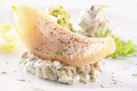 Fish fillet with avocado cream photo
