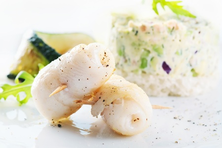 Grilled Fish rolls with avocado cream  photo