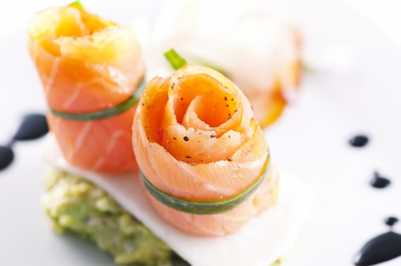 Salmon rolls as tapas photo
