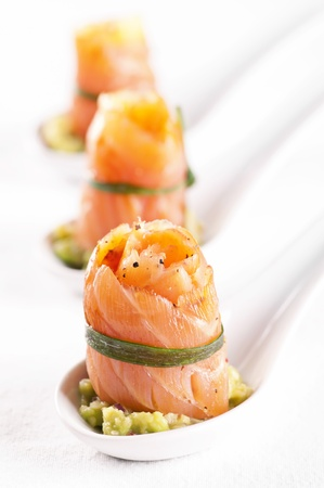 Tapas with Salmon with avocado cream photo