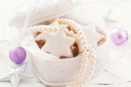 present with cookies and pearl necklace photo